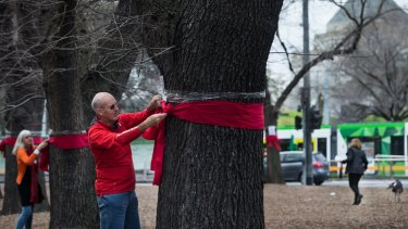 Residents protest over the removal of trees in the St Kilda Road area for the Melbourne Metro Rail project.