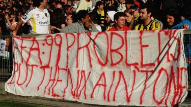 Banner banter: Wellington Phoenix fans make their feelings known at Saturday's game against Melbourne Victory.