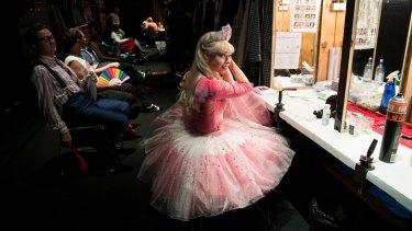 Karina Russll, who plays Veruca Salt, adjusts her earrings backstage.