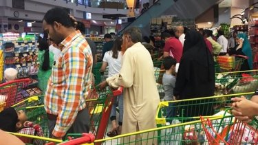 Nervous Doha residents stock up on groceries earlier this month.