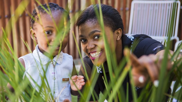 Student Palesa Molefe, 21, of Queanbeyan with her  two-year-old daughter Neriah Ganya at the opening of the new facility at Canberra College.