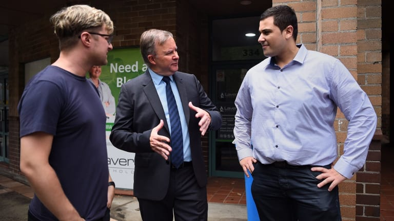 Anthony Albanese (centre) in front of his Marrickville office, Sydney, with two locals affected by the Centrelink debt clawback - Curtis Dickson, 31 (left) and Tony Barbar, 29 (right).