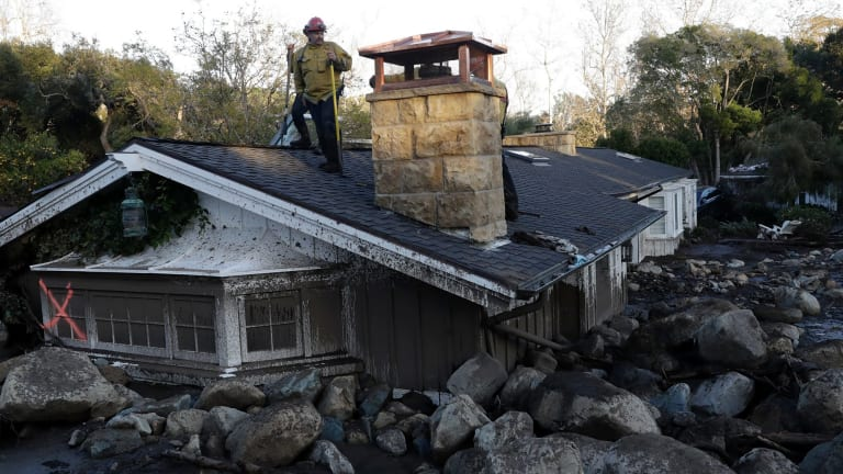 A house is submerged by mud and boulders following the mudslide in Montecito, California.