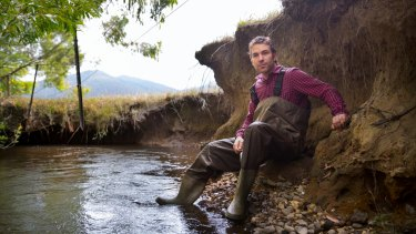 Wetlands ecologist Joe Greet in a waterway near Woori Yallock, where the banks have eroded due to a lack of vegetation.