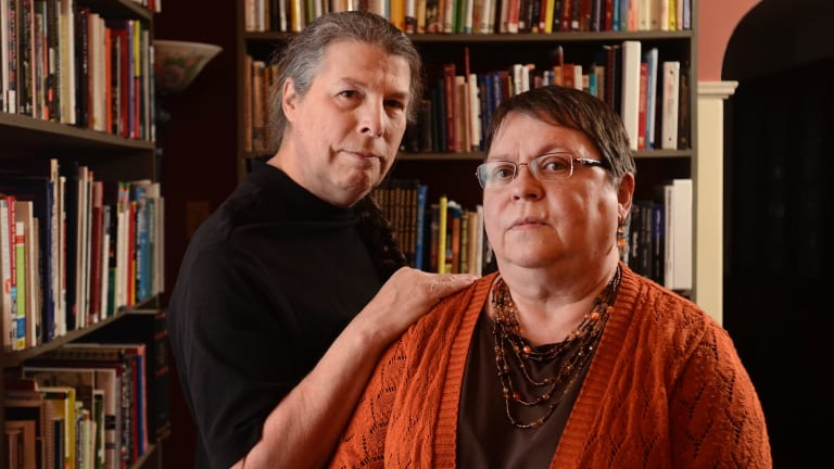 Cheryl Costa, left, and Linda Miller Costa, who published the <i>UFO Sightings Desk Reference</i>, at their home in Syracuse, New York state. The book contains no narrative or anecdotal accounts, just 371 pages of charts and graphs on the geography and timing of UFO reports collected by two volunteer organisations, and the various shapes that witnesses reported.