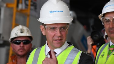 Premier Mike Baird says the government is determined to ensure homes are acquired ''fairly and compassionately'' for WestConnex.