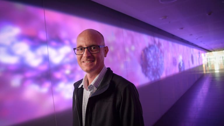 Biomedical animator Drew Berry at the Walter and Eliza Hall Institute's illuminated 27-metre artwork <i>Fiat Lux</i>.