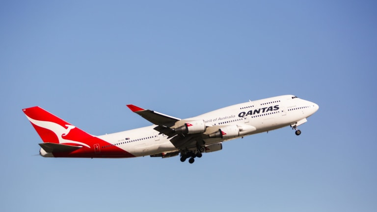 A man had to be restrained and removed from a Qantas flight from Perth to Sydney on Sunday after be became aggressive.