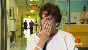 Mr Long wipes tears from his eyes as he recalls the crash.