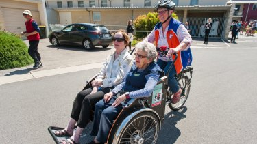 Pedal Power's Collen Laugesen take IRT Kangara Waters residents Anke Burns and Beth Hanrahan along for their Cycling Without Age program.