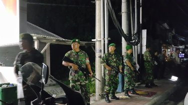 Indonesian army stand guard outside Bali's Kerobokan jail after the deadly gang fight.