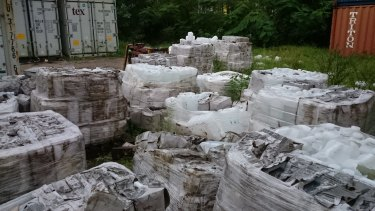 Water containers apparently left to disintegrate in open piles near the Nauru port. Photo believed to be taken late in 2015.
