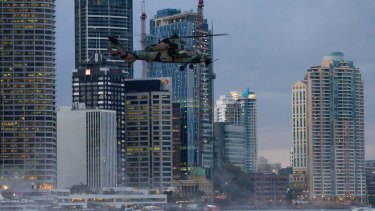 A Tiger attack helicopter goes through its paces in inner Brisbane.