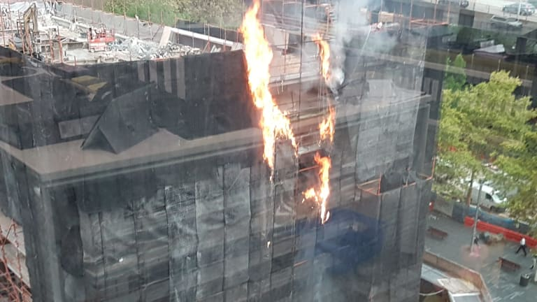 It appeared the fire was on the scaffolding of the building.