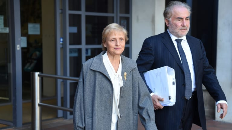 Naturopath Marilyn Bodnar leaves Campbelltown Local Court with her lawyer.
