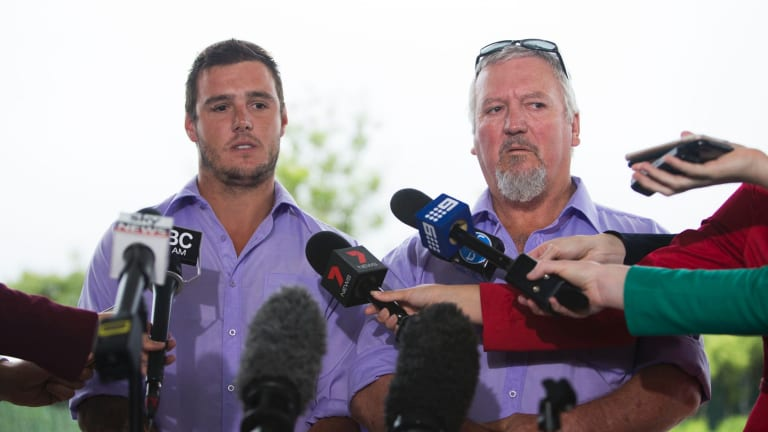 Former foster carers Cameron and Wayne Pemberton speak to media outside court.