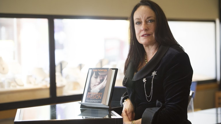 Author Diana Thompson with her debut book <i>Winterflood's Passion</i>.