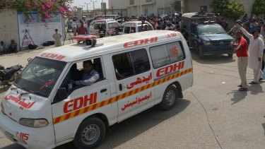 Ambulances transport the bodies of Shiite Muslims killed in a massacre by Islamic State gunmen in Karachi.
