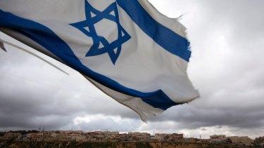 An Israeli flag flies on a hill near the West Bank Jewish settlement of Elazar.