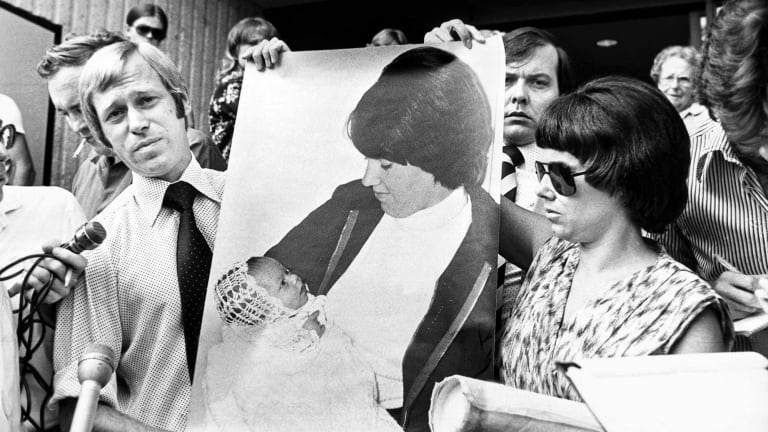 The disappearance of baby Azaria from a camping ground at the base of Uluru in 1980 forced Lindy and her husband, Michael (right), in front of the cameras for many years.