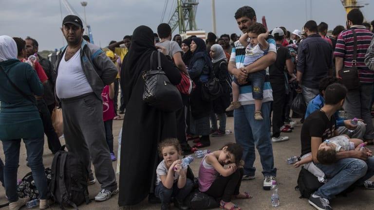 Asylum seekers arrive in Sicily.