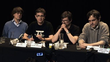 Charlie Hebdo satirical newspaper cartoonists Cabu, Charb, Luz and Riss give an editorial conference at the Theatre du Rond-point in Paris, one day after the publication's offices were destroyed in a petrol bomb attack on November 3, 2011.