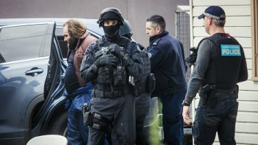 Phillip Galea is led from a house by police during a terror raid in Ballarat Road, Braybrook, on Saturday.