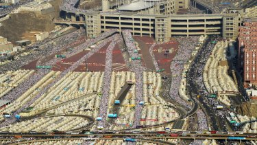 Hundreds of thousands of pilgrims make their way to cast stones at a wall symbolising Satan, in Mina on the outskirts of the holy city of Mecca on September 24, the day of the fatal stampede.