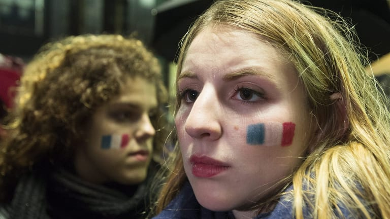 People attend a vigil outside the French consulate in Montreal, Canada, following the terror attacks in Paris.