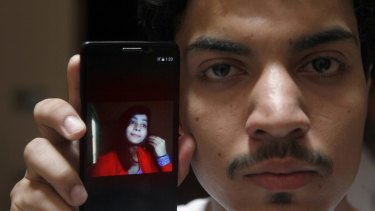 Hassan Khan shows the picture of his wife Zeenat Rafiq, who was burnt alive.