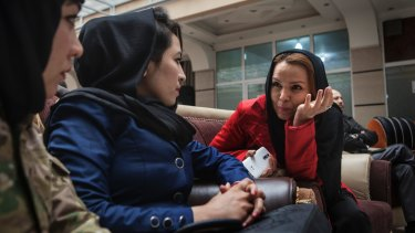 Zahra Yaganah, right, an activist, writer and divorced mother of two teenagers, speaks with Fatima Qasemi, left, and Gulab Hiaidari at an International Women's Day event in Kabul.