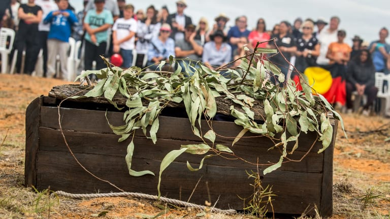 The casket made from a 5000-year-old red gum containing Mungo Man's remains back on country after a four-decade fight for repatriation.