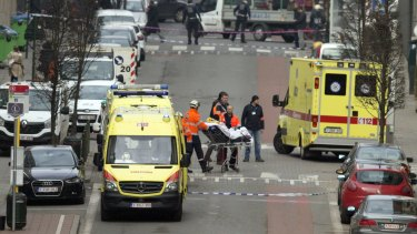 A victim of the Maalbeek metro station blast is taken from the scene by paramedics.