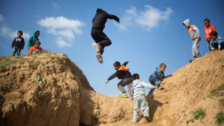 Israeli Bedouin children play before a rally marking the 40th anniversary of Land Day and against a plan to uproot the Negev Desert village of Umm al-Hiran in 2016.