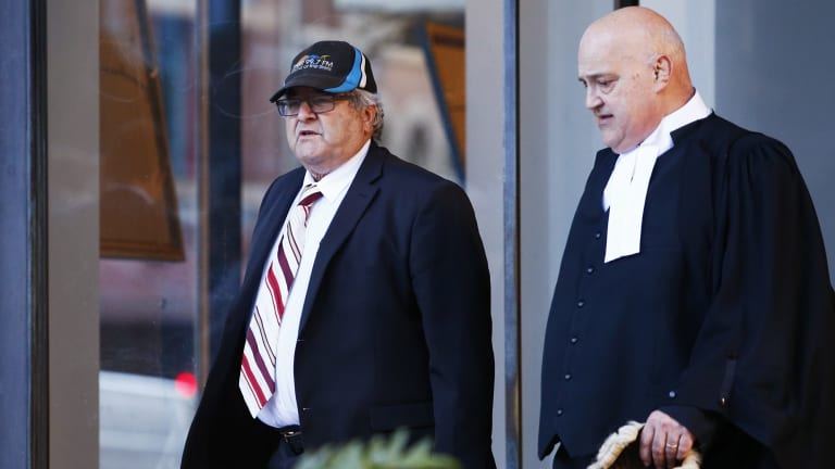 Neil Albert Futcher (left) and his lawyer John Galluzo leaving court in August 2016.