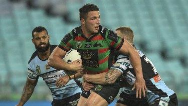 Dominant: Rabbitohs star Sam Burgess holds off the Cronulla defence.