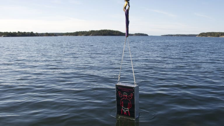 Meant to repel homophobic Russians ... The Singing Sailor, a waterproof box with a neon sign of a sailor in his underpants and the Russian message 'Welcome to Sweden - Gay since 1944', is lowered into the sea near Stockholm.