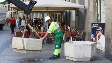 Municipal workers place street furniture on Puerta del Sol street as a security measure in Madrid, following the Barcelona attack.