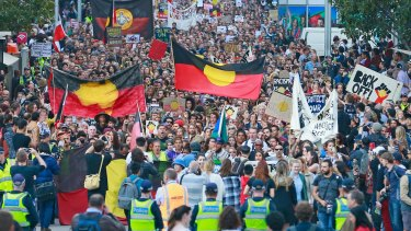 Protesters march through the streets of the Melbourne CBD on May 1.