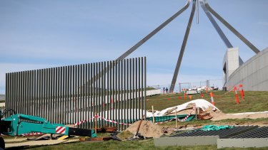 A security fence is installed across the lawns of Parliament House in Canberra on Tuesday.