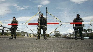 Colombian soldiers stand guard at Simon Bolivar international bridge, on the border with Venezuela.