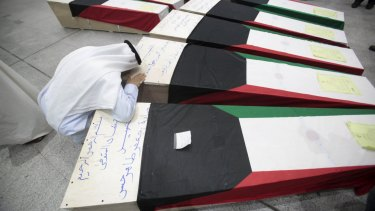 The coffins of victims of the bombing at the Imam Sadeq mosque in Kuwait City.