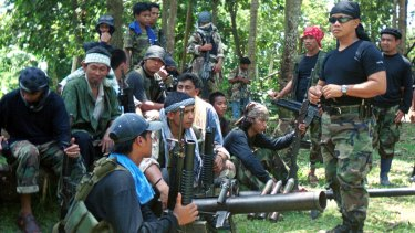Abu Sayyaf spokesman Abu Sabaya, right foreground, with militants in Basilan, the Philippines.