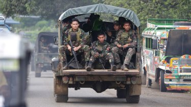 Soldiers ride a military vehicle on the outskirts of Marawi city, southern Philippines, earlier this month.