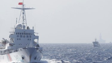 Chinese Coast Guard ships near a Chinese oil rig in disputed waters.