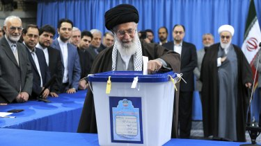 Iran's Supreme Leader Ayatollah Ali Khamenei casts his ballot during parliamentary and Experts Assembly elections in Tehran.