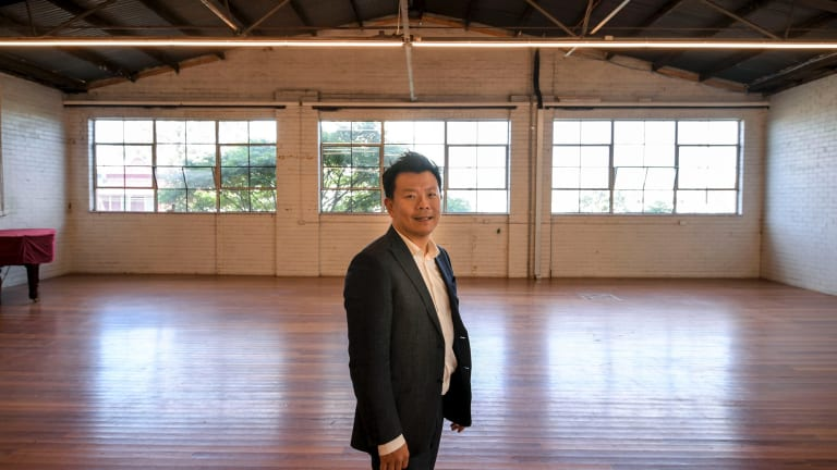 Mr Wu in the North Melbourne building he has bought for $2 million to convert into performing arts studios.