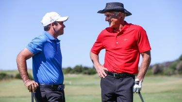 Greg Norman chatting with rising young star Antonio Murdaca on the practice range at New South Wales Golf Club during a golf clinic.