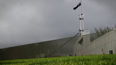 The security fence nears completion at Parliament House on Monday.