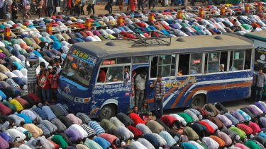 Bangladeshi Muslim devotees offer prayers  in Tongi, 20 kilometres  north of Dhaka, Bangladesh.